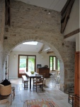 In a quiet area close to amenities, Stone restored house and pool.