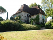 At the borders of both the Lot and the Dordogne, Manor with country house