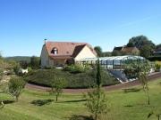 Maison d'architecte avec piscine couverte et terrain constructible