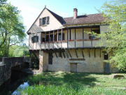 Renovated watermill with landscaped grounds, close to all services.