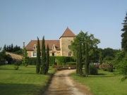 In a village, beautiful manor house with gîtes and swimming pools