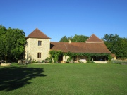 In the countryside, stone character house and outbuildings