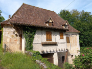 Water mill for sale on the banks of the Lot, large living room, outbuilding